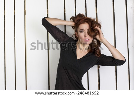 stressed young woman on a white background