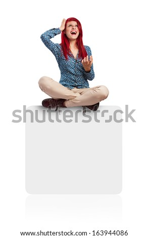 stressed young woman sitting on a white box isolated - stock photo
