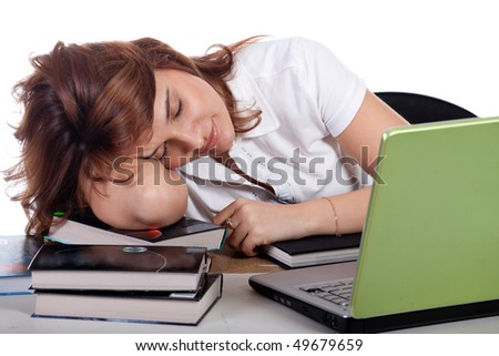 Stressed young woman sleeping at office desk
