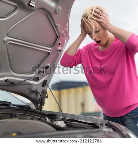Stressed Young Woman with Car Defect. Engine breakdown. - stock photo