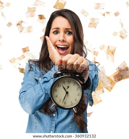 stressed young woman with clock - stock photo