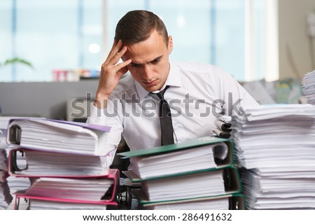 Stressful manager have so many paperwork in the office