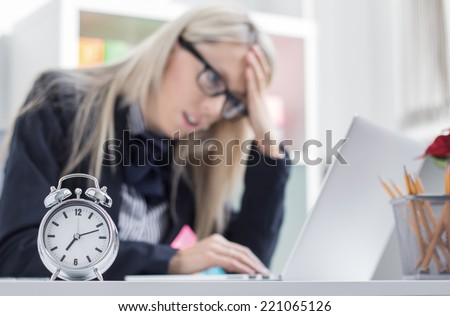 Stressful woman can't finish job on time - stock photo