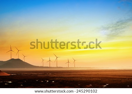 Stretch as far as eye can see the grass and the horizon distance, wind turbine. - stock photo