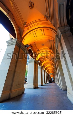 Stretch of pillars of old building - stock photo