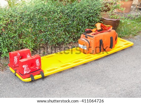 stretcher for emergency paramedic service  medical equipment on road surface background - stock photo