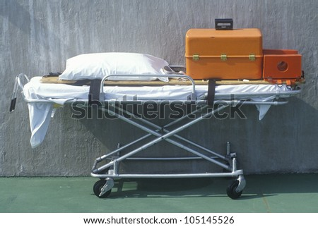 Stretcher with emergency medical equipment - stock photo