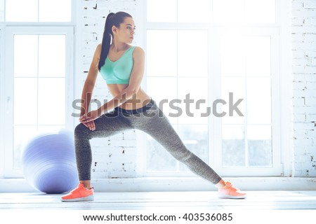 stretching after great workout young beautiful stock photo