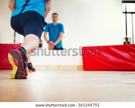 Stretching at gym. - stock photo