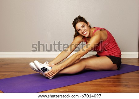 stretching before a workout - stock photo