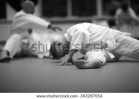 Stretching exercises before martial arts training - stock photo