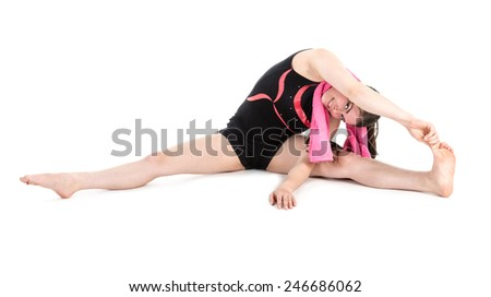 Stretching fitness woman on floor touching her foot with her fingers, isolated on white - stock photo