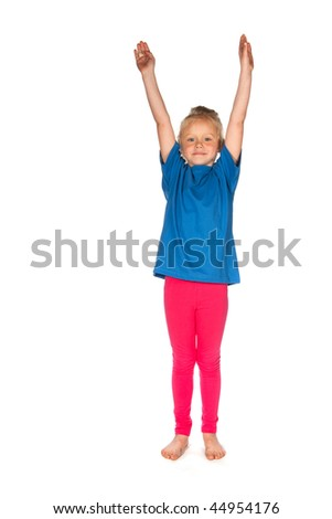 stretching little girl in blue and pink