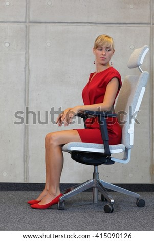 stretching on chair in office - business woman exercising  - stock photo