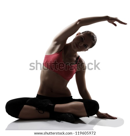 stretching sport woman full length portrait, silhouette studio shot over white background - stock photo