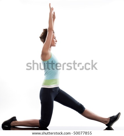 stretching workout posture by a woman on studio white background - stock photo