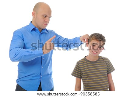 Strict father punishes his son. Isolated on white background - stock photo