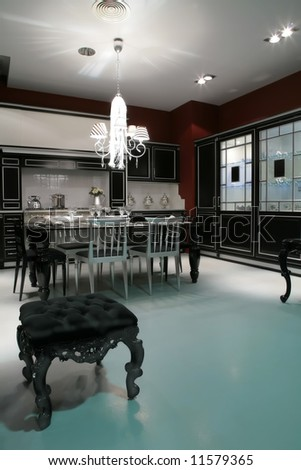 Strict interior of the black-silvery kitchen with banquet on foregrounds