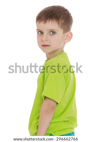 Strict the little blonde boy with big eyes, staring into the camera turned sideways - isolated on white background - stock photo