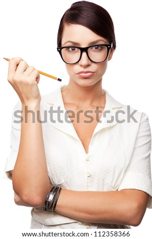 Strict woman in large glasses, isolated on white background - stock photo