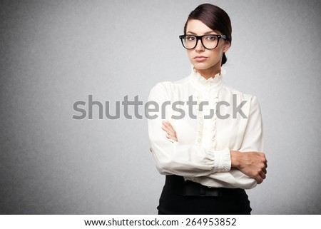 Strict woman in large glasses, isolated on white background