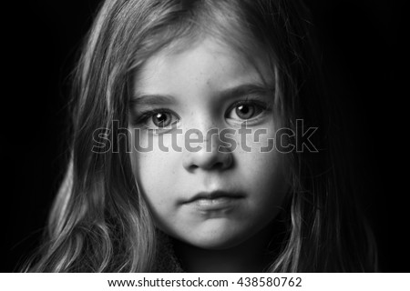 Striking black and white portrait of young girl  - stock photo