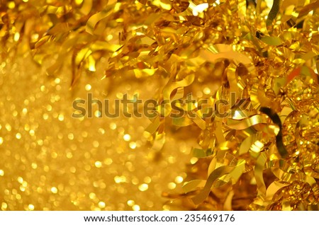Striking golden ribbons for Christmas & Chinese New Year decorations / Christmas & Chinese New Year celebrations / golden backgrounds - stock photo