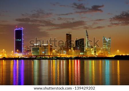 Striking illumination & reflection of Bahrain highrise, HDR photograph - stock photo