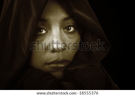 Striking Image of Fashion Model On Black with Cape