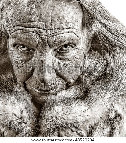 Striking Monochrome Portrait image of an Old woman In Fur - stock photo