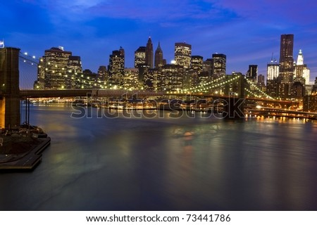 Striking photograph of downtown Manhattan Skyline and Brooklyn Bridge across the East River - stock photo
