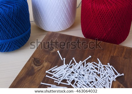 String art crafts on a wooden background