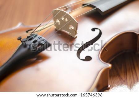 """string instrument """"violin"""" on wood background - stock photo"""
