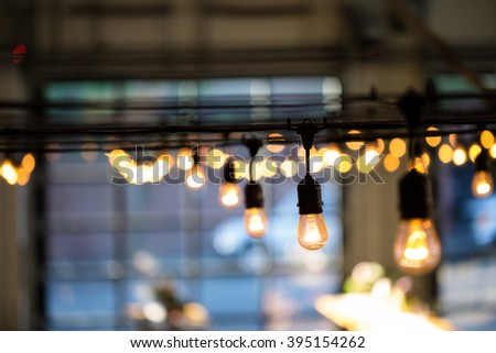 String lights lighting a wedding reception in the Winter in Oregon. - stock photo
