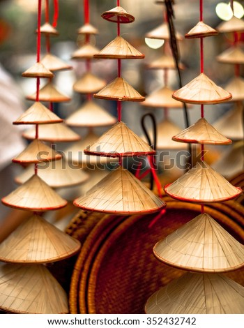 String of multi sized conical Vietnamese hats for sale in Hanoi, Vietnam