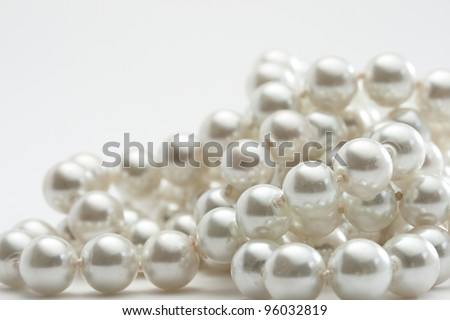 String of pearls on white - stock photo