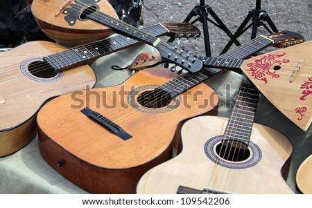 Stringed musical instruments guitar and balalaika