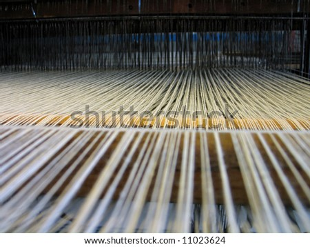 Strings in a hand-loom - All strings attached - Textile abstract - stock photo