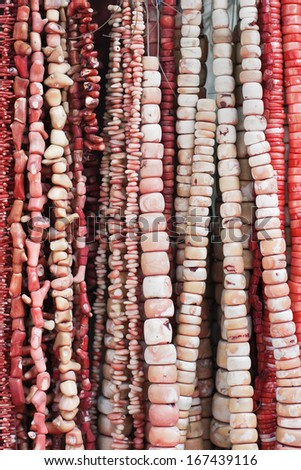 strings of red beads on a market stall, Beijing, China - stock photo