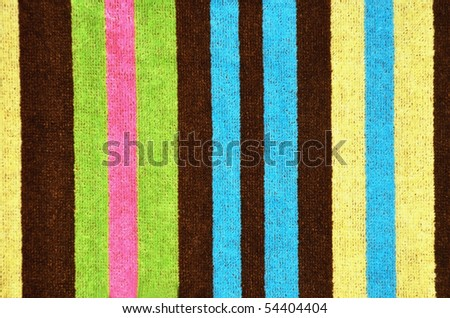 Striped beach towel useful as a background pattern - stock photo