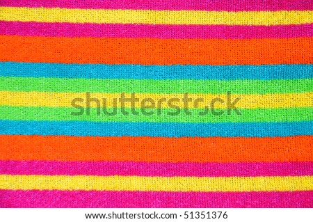 Striped beach towel useful as background texture or pattern - stock photo