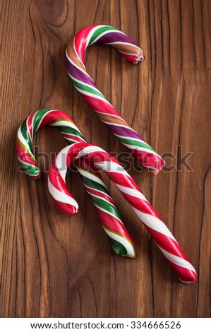 Striped christmas candy on a wooden - stock photo