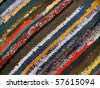 striped colorful handicraft rug from cotton fabric - stock photo