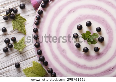 striped currant cheesecake close-up on the table. horizontal view from above