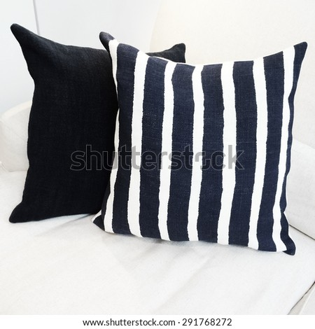 Striped cushion on a white sofa. Modern furniture. - stock photo