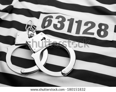 Striped dress for prisoners with number - stock photo
