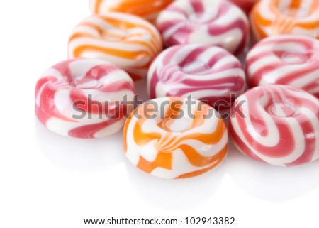 striped fruit candies isolated on white - stock photo