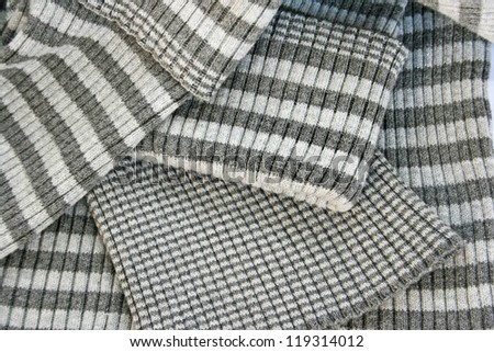 Striped gray knitwear as a background. - stock photo