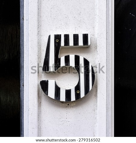 Striped House number five. - stock photo