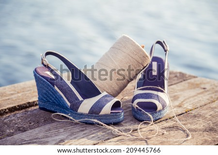 Striped sandals, lie on breast lake, ball of yarn, Women's Shoes - stock photo